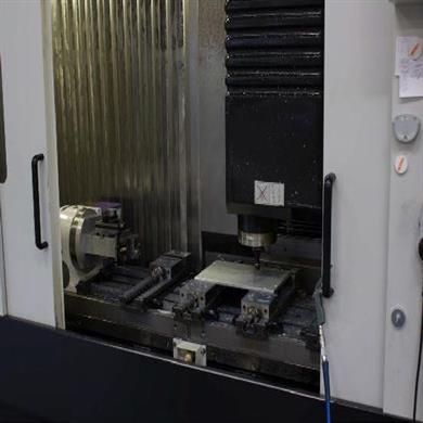 A CNC millingmachine mills the Top Plate of the Signature branch box with an accuracy to one-thousandths of a millimeter.